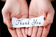 hands holding a thank you note